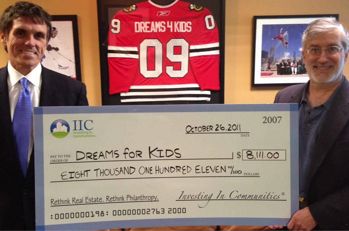 IIC Big Check to Dreams 4 Kids