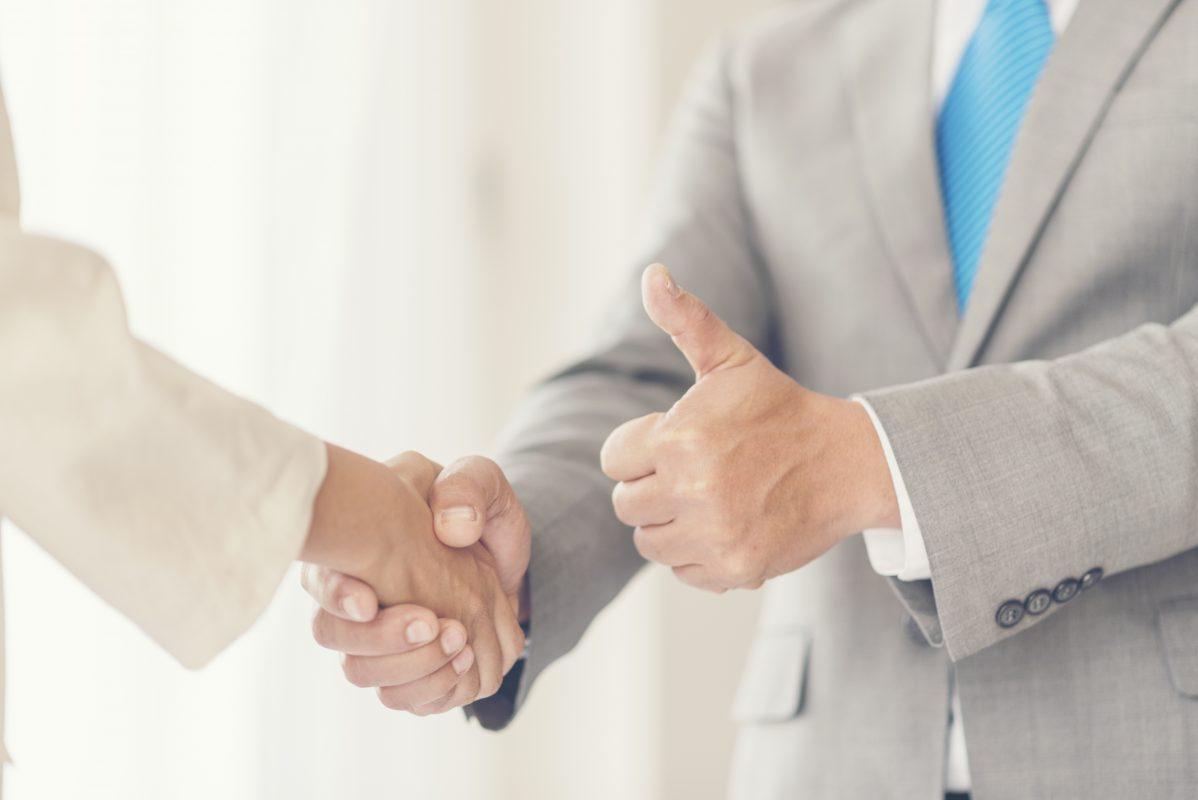 thumbs up handshake